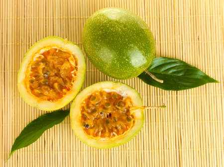 green passion fruit on straw background close-up photo