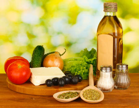 greek cuisine: Ingredients for a Greek salad on green background close-up