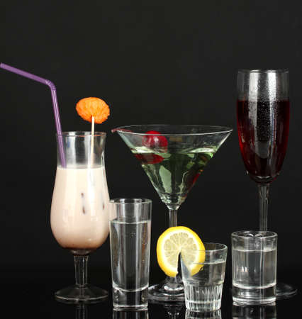 a variety of alcoholic drinks isolated on black photo