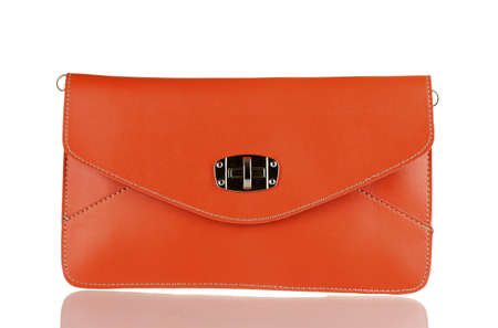beautiful orange leather woman bag isolated on white photo