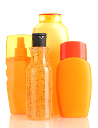sunblock: Bottles with suntan cream isolated on white
