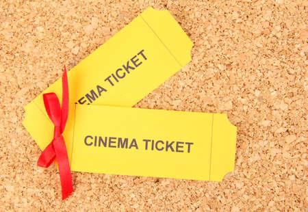 Cork board with cinema tickets photo