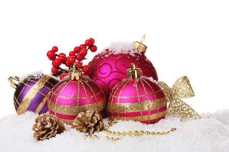 beautiful pink Christmas balls and cones on snow isolated on white photo