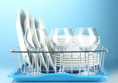 clean dishes on stand on blue background Stock Photo - 14370296