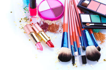 set up: make-up brushes in holder and cosmetics isolated on white Stock Photo
