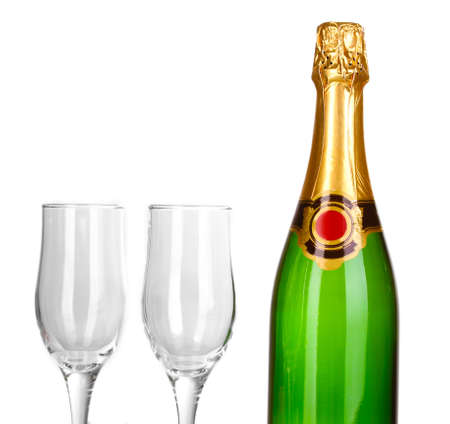 gold capped: Bottle of champagne and goblets isolated on white