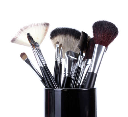 make-up brushes in black cup isolated on white photo