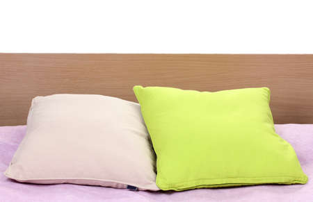 bright pillows on bed on white background Stock Photo - 14370737