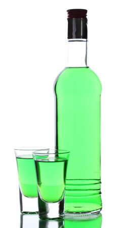 intoxicate: bottle and two glasses of absinthe isolated on white