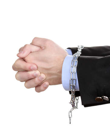 Businessman hands fettered with chain isolated on white Stock Photo - 14435495