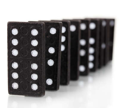 cause and effect: Dominoes isolated on white