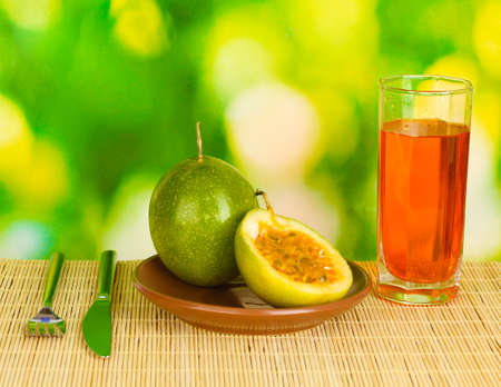 Green passion fruit in the plate on bright green background photo