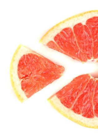 Slice of grapefruit isolated on white photo