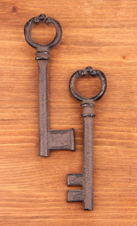 Two antique keys on wooden background Stock Photo - 14456732