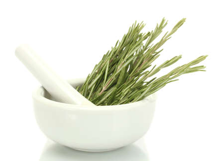 lavage: mortar with fresh green  rosemary isolated on white