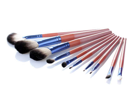 make-up brushes isolated on white photo