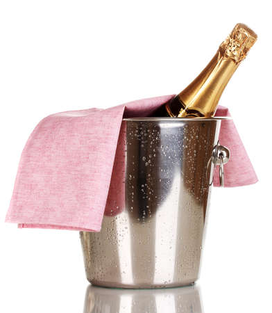 gold capped: Bottle of champagne in bucket isolated on white