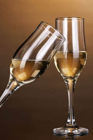 gold capped: Glasses of champagne on brown background
