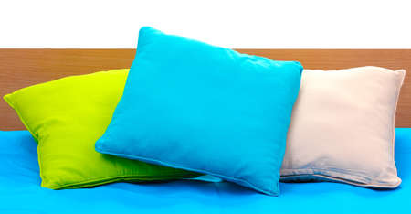 bright pillows on bed on white background Stock Photo - 14456622