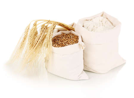 Flour and wheat grain isolated on white photo