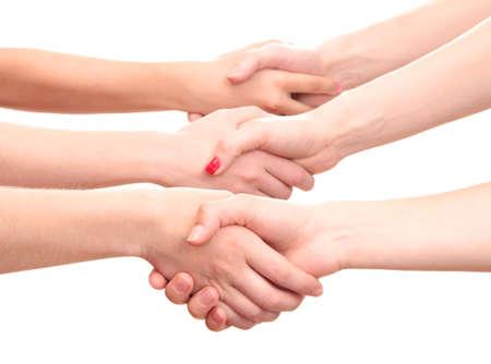 manos estrechadas: grupo de las manos de los j�venes aislados en blanco Foto de archivo