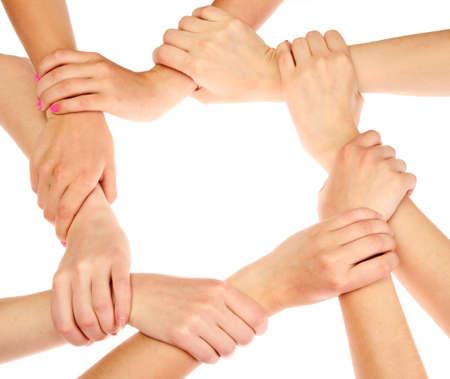 manos juntas: grupo de las manos de los j�venes aislados en blanco Foto de archivo