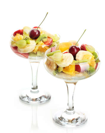 Fresh fruits salad isolated on white photo