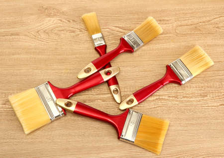 paint brushes on wooden background photo