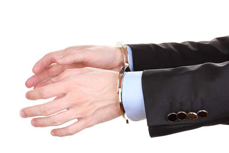 fettered: Businessman hands fettered with handcuffs isolated on white