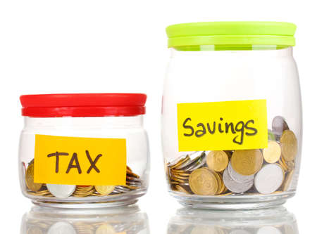 tax tips: Glass banks for tips with money isolated on white