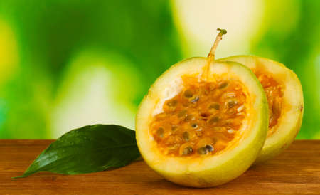 green passion fruit on bright green background close-up photo