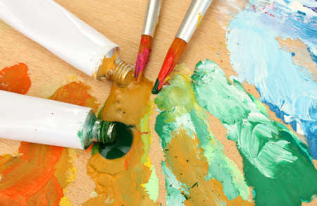 Abstract acrylic paint, paint tubes and brushes on wooden  palette Stock Photo - 14477950