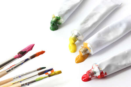 Abstract acrylic paint, paint tubes and brushes isolated on white Stock Photo - 14477163