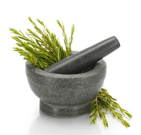 rosemary: mortar with fresh green  rosemary isolated on white