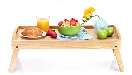 light breakfast on wooden tray isolated on white photo
