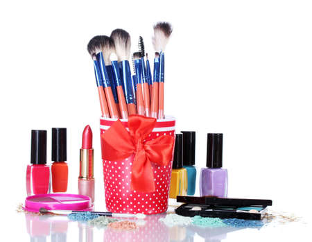 make-up brushes in cup and cosmetics isolated on white Stock Photo - 14463919