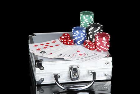 Poker set on a metallic case isolated on black background Stock Photo - 14497407