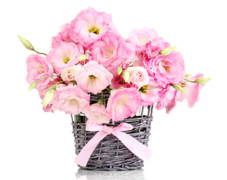 valentina: bouquet of eustoma flowers in  wicker vase, isolated on white
