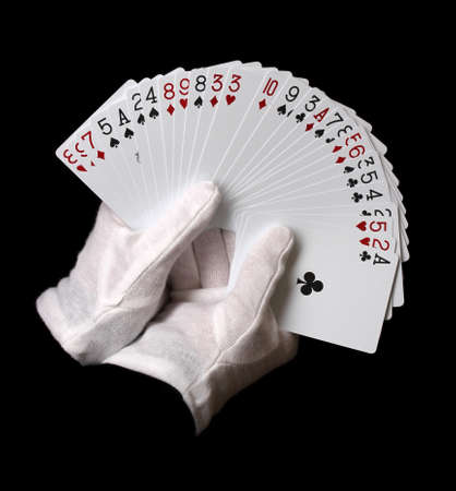 holdem: Cards in hands isolated on black