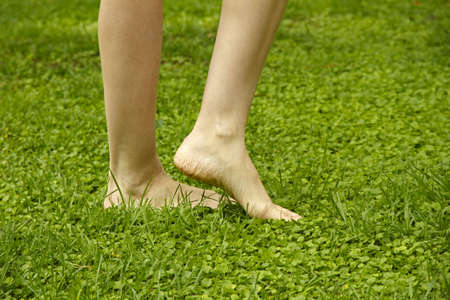 young girl feet: Legs walking on lawn Stock Photo