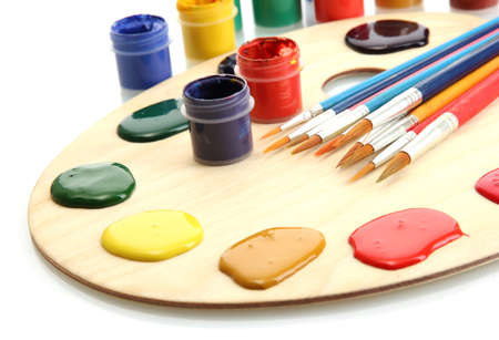 wooden art palette with  paint and brushes isolated on white Stock Photo - 14528559