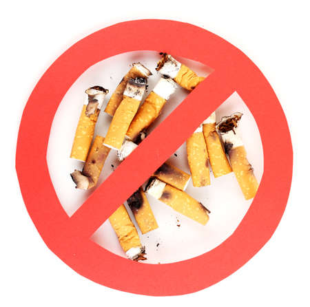 Cigarette butts with prohibition sign isolateed on white photo