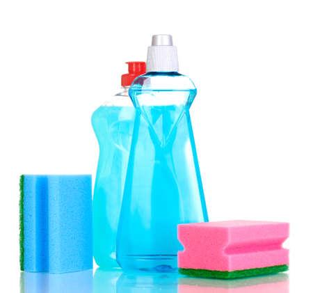 dishwashing: L�quidos para lavar platos y esponjas aisladas en blanco Foto de archivo