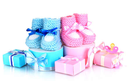 dummies: baby boots, pacifier, gifts and blank postcard  isolated on white