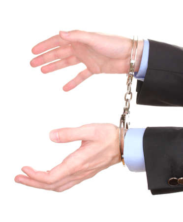 Businessman hands fettered with handcuffs isolated on white Stock Photo - 14533139