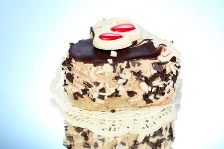 sweet cake with chocolate  on blue background photo