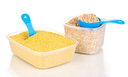 Measuring spoons and plastic containers with grain isolated on white photo