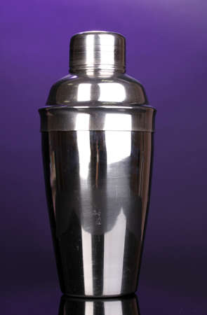 Cocktail shaker on violet background photo
