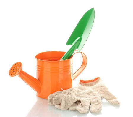 Gardening trowel, watering can and gloves isolated on white photo