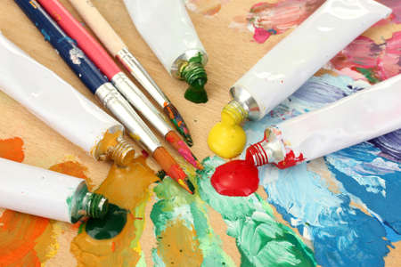Abstract acrylic paint, paint tubes and brushes on wooden  palette Stock Photo - 14536713